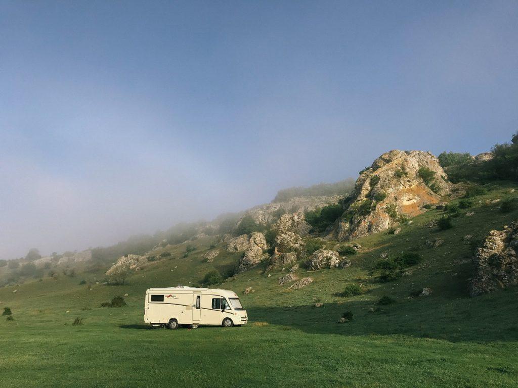 RV parked in a grassland
