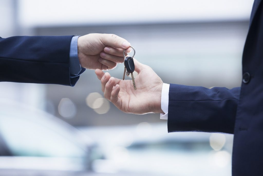 man handling keys to buyer