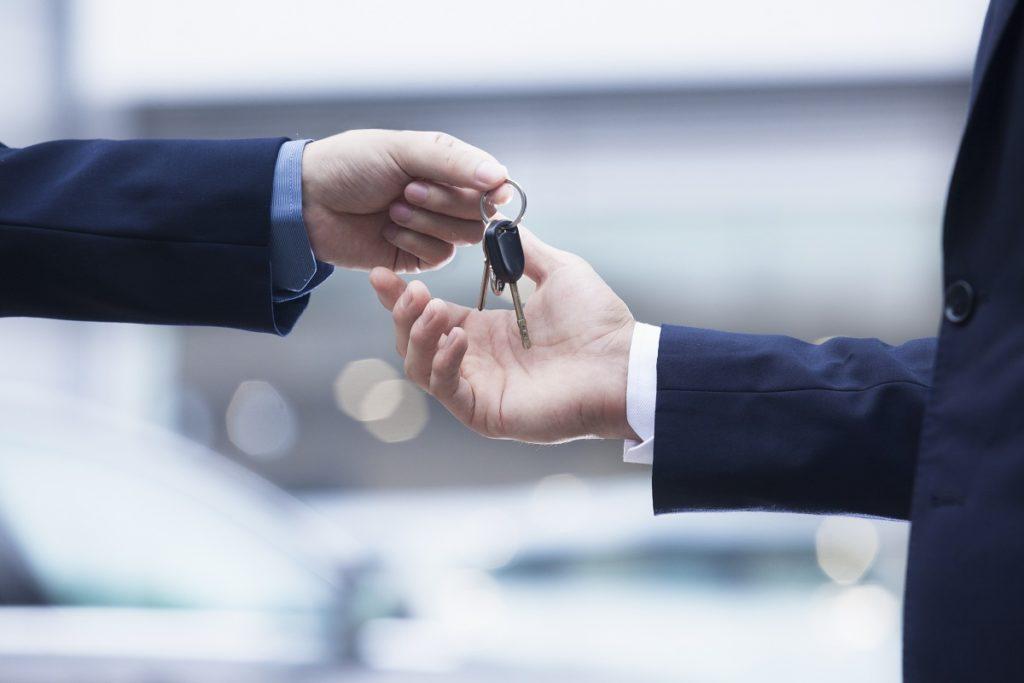 man handling keys to buyer