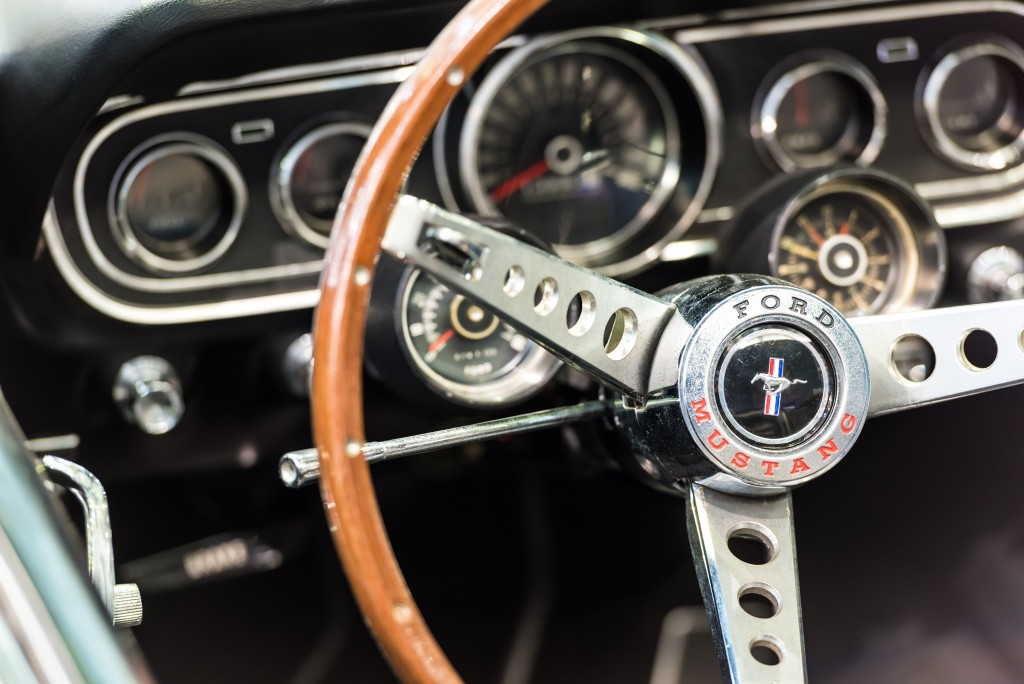 vintage car steering wheel and gauge cluster